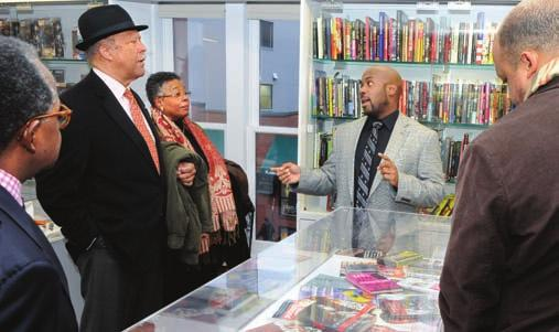 Alvin Benjamin Carter III shows the Hiphop Archive Research Institute to Ernest J. Wilson III. J. Cole in the Hiphop Archive.