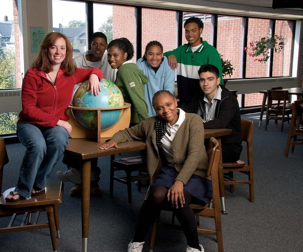 Working together at Fox Middle School are (from left) Jacqueline Nappi 09; eighth-graders Morgan Mitchell, Shauniqua Blake, Thomas Cruz, and Patricia Pipkin (seated); Andrew Mitchell 09 (standing);