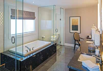 MASTER ENSUITE The spa-inspired retreat offers a relaxing soaker tub with tile or optionable marble surround, a separate glass