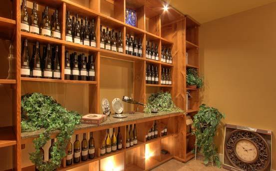 Lower Level Wine Room: A wine collector s dream - granite counter and custom built-in shelving to house many bottles of wine.