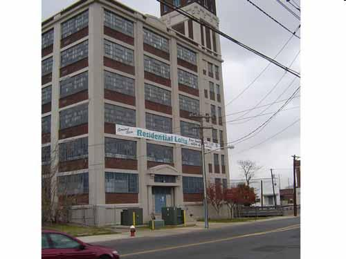 Housing Choices Redevelopment Plan: Encourages the development of the Lee Overalls building at East State