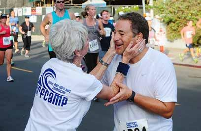 The Beach Reporter October 9, 2014 5 Celebrating 37 Years of the M.B. 10K A volunteer offers encouragement to a runner.
