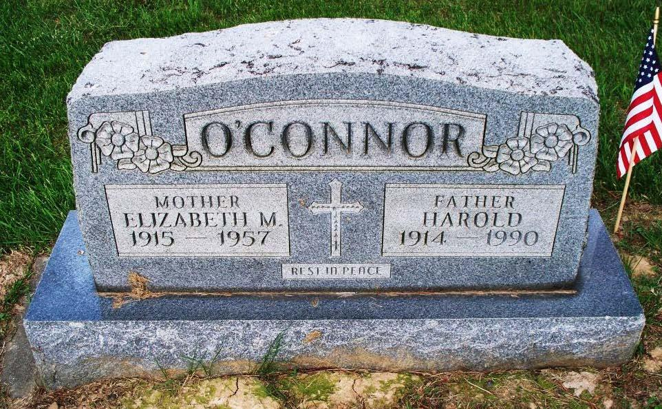 He is buried in the center section of St. Peter s Cemetery.