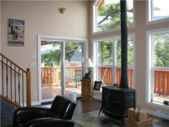around deck. Three large bedrooms with master bedroom having an adjacent sitting room or office.
