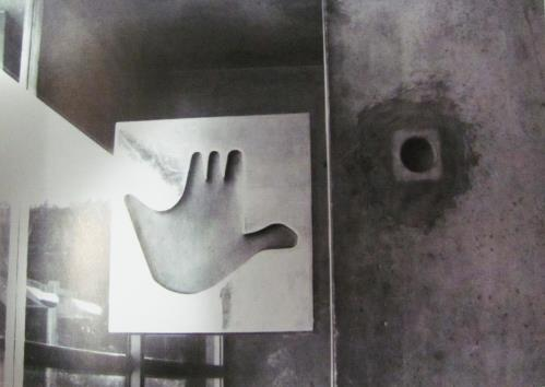 My hand is received by the handle; it is mirrored by its forms, like holding Figure 8: Door at Maison des Jeunes, 1965.. hands with another person.
