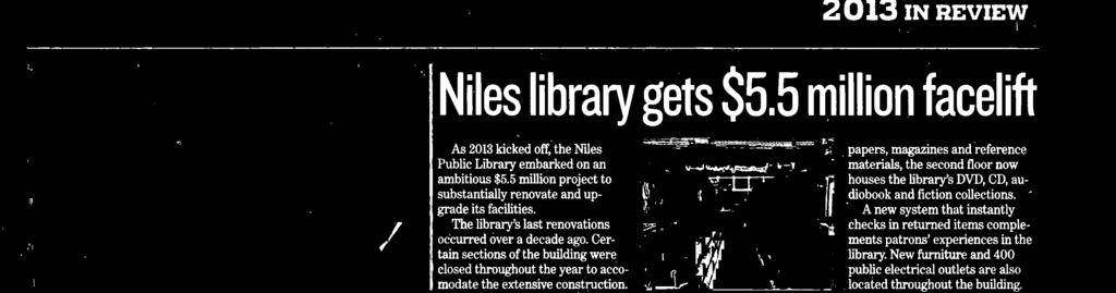 The library topped its interior renovations with the October nveiling of a 15-foot-tall, globe-like wooden sclptre commissioned by Friends of the Niles Library.