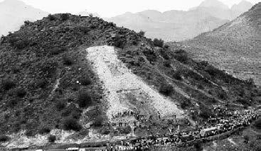 In 1914, Coach Pop McKale s football team was so successful that discussions began to honor the team and the University by building a huge A on Sentinel Peak, west of downtown Tucson.