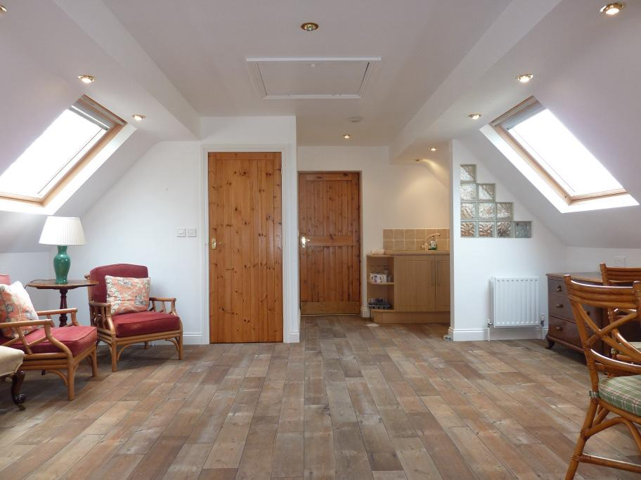 Annexe/Studio Patio area at the top of the stairs with views towards Snaefell and surrounding hillsides.