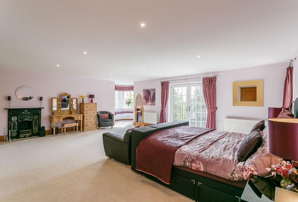 Two further double bedrooms and bathroom together with a large games room which overlooks the front elevation.