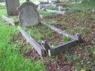 Tall headstone with a pointed top and edging. The first part of the inscription is carved, the remainder is leaded. U.H.
