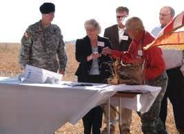 Officials gather in Flint Hills to sign easement By Lynn Byczynski On an unseasonably warm November morning, more than 100 people gathered on a ridgetop high in the Flint Hills to celebrate the