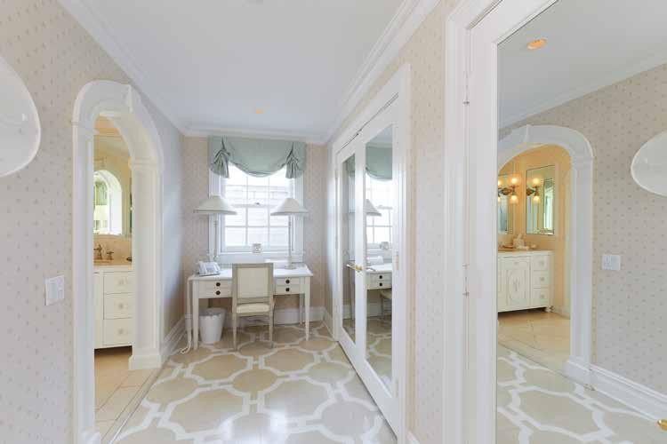 The master bathroom features a dressing room with