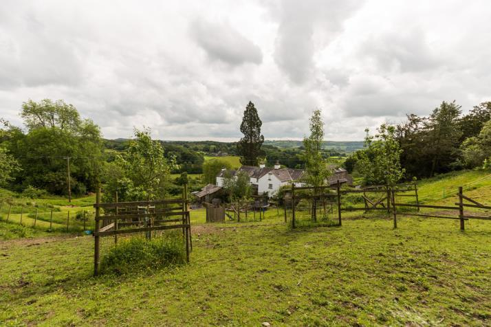 86 acres of gardens and grounds including a stable and pony paddock, orchard with fruit trees and ample parking.
