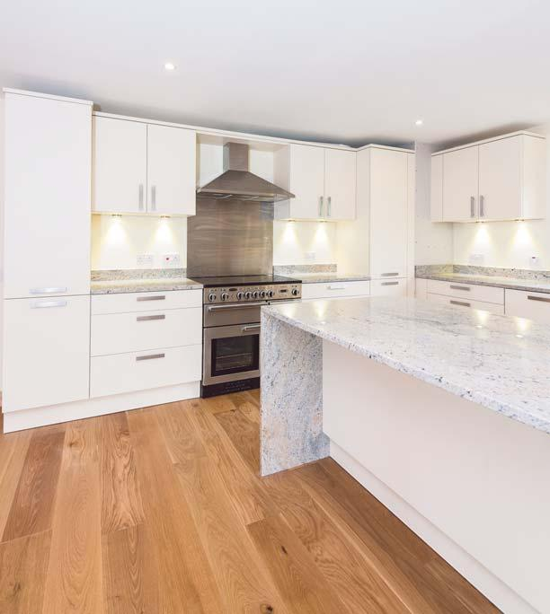 The kitchen is fitted with tasteful neutral wall and floor-mounted units with wonderful solid worktops complimenting the natural colours on show through the picture window.