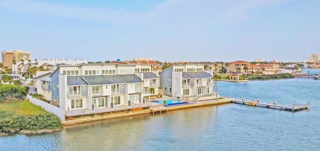 EXPLORE The Possibilities Beautiful, gated, Bayfront, townhome style condominiums, with a contemporary flare.