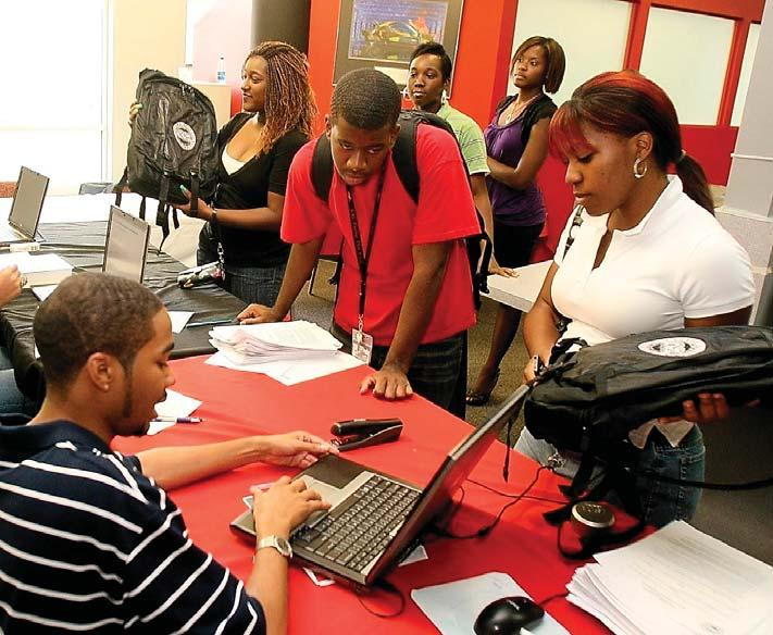 Freshman students receive laptops as part of a pilot program funded by Title III. III, CAU has worked to ensure its students are properly equipped for 21st century learning.