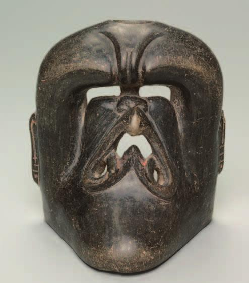Vessel with Deity Mask. Central Mexico, Olmec style; 1200 900 BC; darkware ceramic, traces of pigment; 17.9 x 16.5 x 15.3 cm; Purchase from the J. H. Wade Fund 2002.67 Female Worshiper.