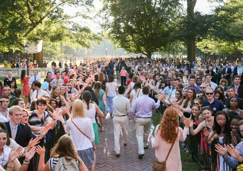 students in a special procession from the front lawn to the Wren portico, where the new students are