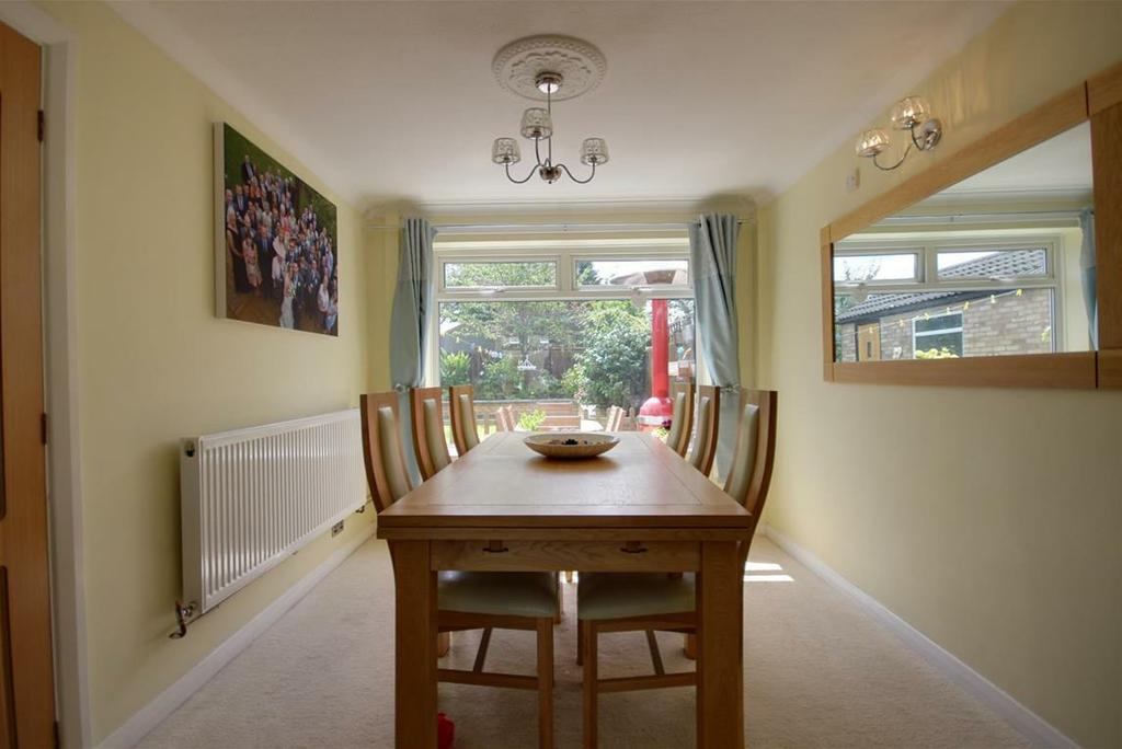 "DINING AREA 10'9"" x 8'11"" approx (3.28m x 2.72m approx) With coving and upvc double glazed window to rear."