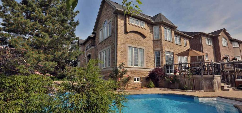 Additional Features Upgraded brick and stone exterior Amazing oversize irregular shaped corner lot with extensive lush landscaping with towering tees, stone lined planting beds and armour stone