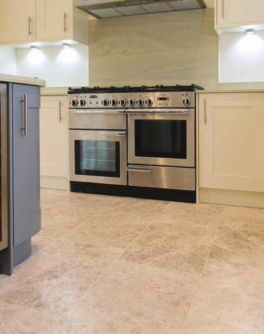 KITCHENS Bespoke kitchen (subject to build stage) with integrated appliances including 5 ring gas hob, double oven, extractor hood, dishwasher & fridge / freezer and boiling tap.