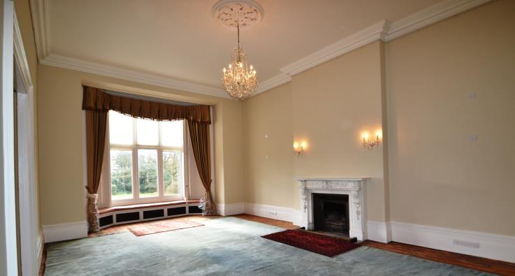 31m) With view to the surrounding grounds and doors opening to the Drawing room.