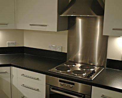 Specification Kitchen Contemporary fitted kitchen Stainless steel oven, hob and extractor hood Stainless steel sink with chrome mixer tap Worktop with matching up stand and