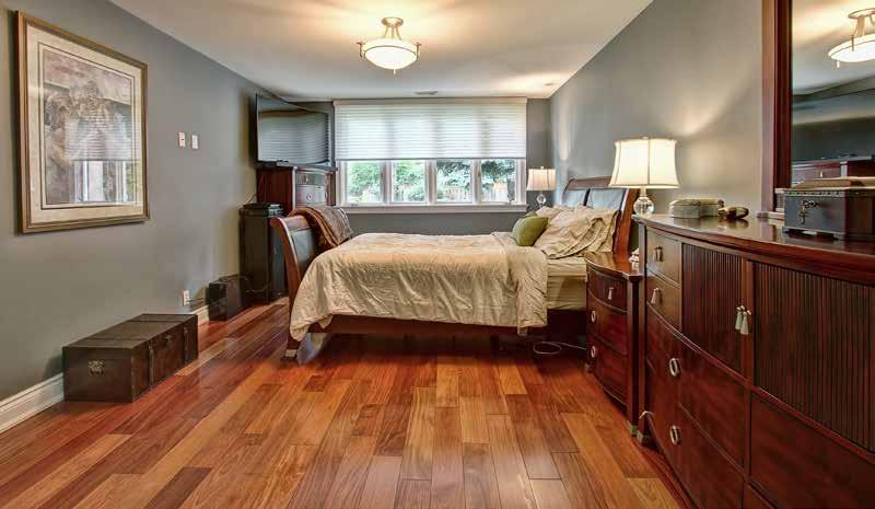 The main floor bedroom wing features a private entrance to two updated