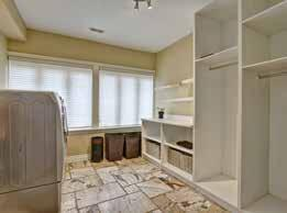 detail, two walk-in closets with custom closet organizers, luxurious