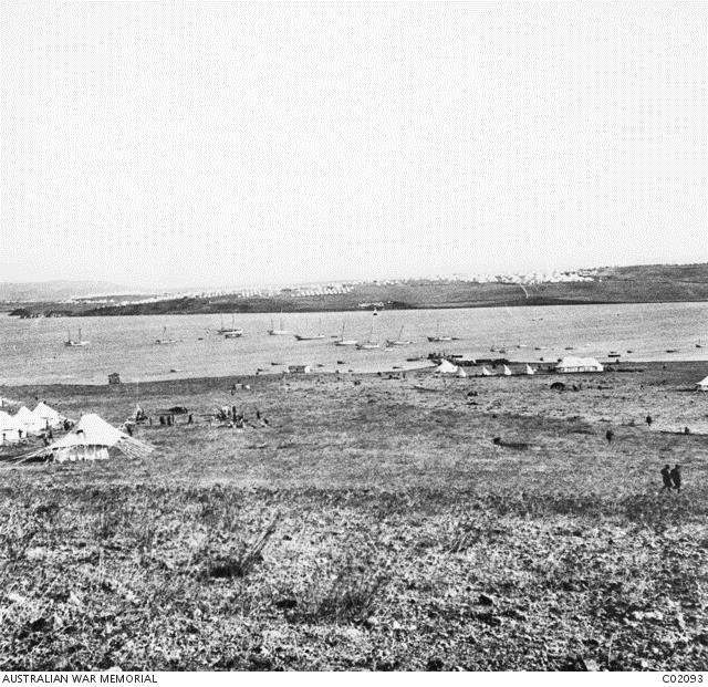 Mudros harbour on the Aegean island of Lemnos, seen from above the 1st Battalion's camp. The tents visible on the other side of the harbour are those of the 2nd Australian Stationary Hospital. 1915.