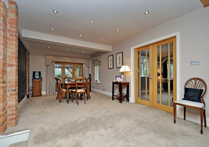 ACCOMMODATION A panelled front door leads to an ENTRANCE HALL with steps leading to a well appointed, contemporary CLOAKROOM and a superb open-plan, galleried RECEPTION HALL beyond with oak flooring,