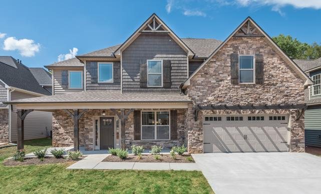 Design Features Exterior Features: Craftsman-style exteriors with stone, brick and vinyl shake finishes Hand-crafted, stained wooden accents 3 sides 6 vinyl plank siding Craftsman covered rear patio