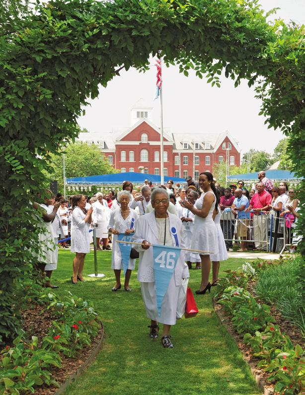 Class Day 2012: Seniors join alumnae in the March Through the Arch, symbolizing their leaving