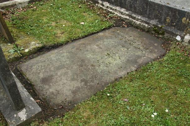 POSITION See Plan D15 Headstone, lying flat. Surface generally worn, but text still legible.