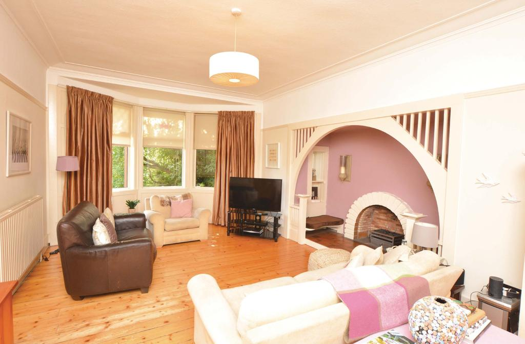 An attractive period detached villa set within large private mature garden grounds.
