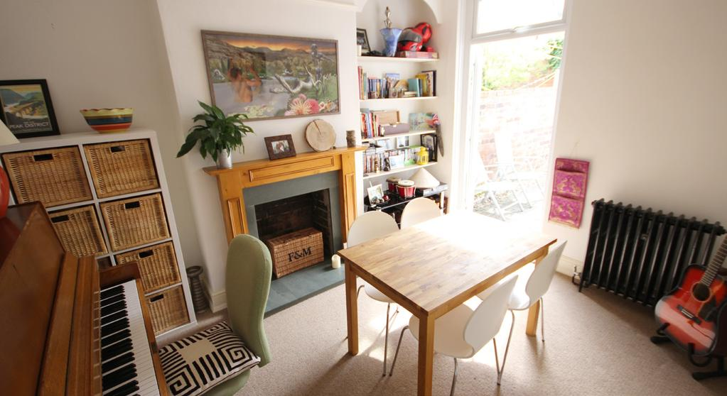 ) Accessed directly from the spacious hallway, the dining room has french style patio doors opening out to the rear garden, allowing light to flood into the room.