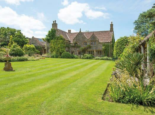 Beyond the formal garden is the former kitchen garden, which overlooks Sutton Bingham Reservoir and is now laid to lawn, with a natural stone-lined heated swimming pool to one side.