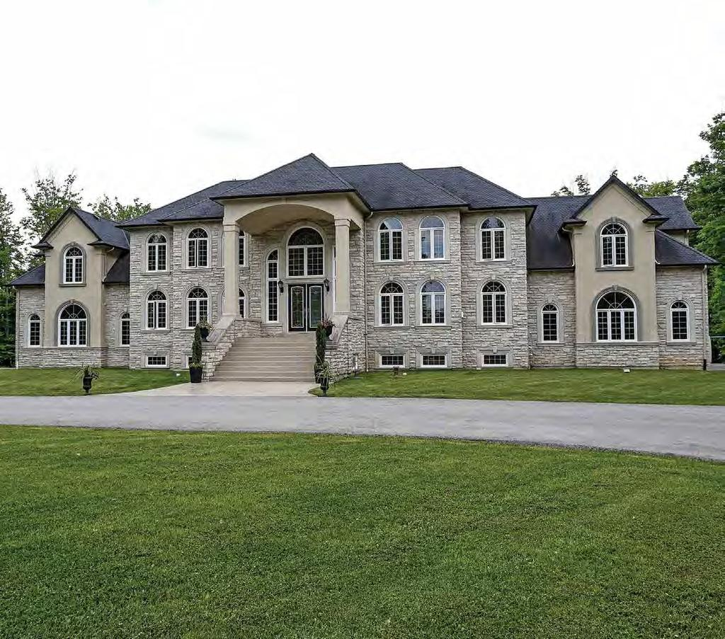Secluded ESTATE on over 12 acres This opulent Estate home is conveniently located just outside the boundaries of Hamilton and Grimsby making it the ultimate in private lifestyle with all that the