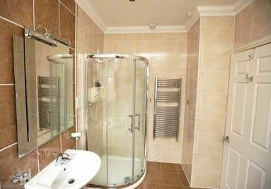 18m) Fitted with a luxurious four piece suite comprising fully tiled walk-in shower cubicle with power shower, panelled bath, pedestal wash hand basin and low flush toilet.