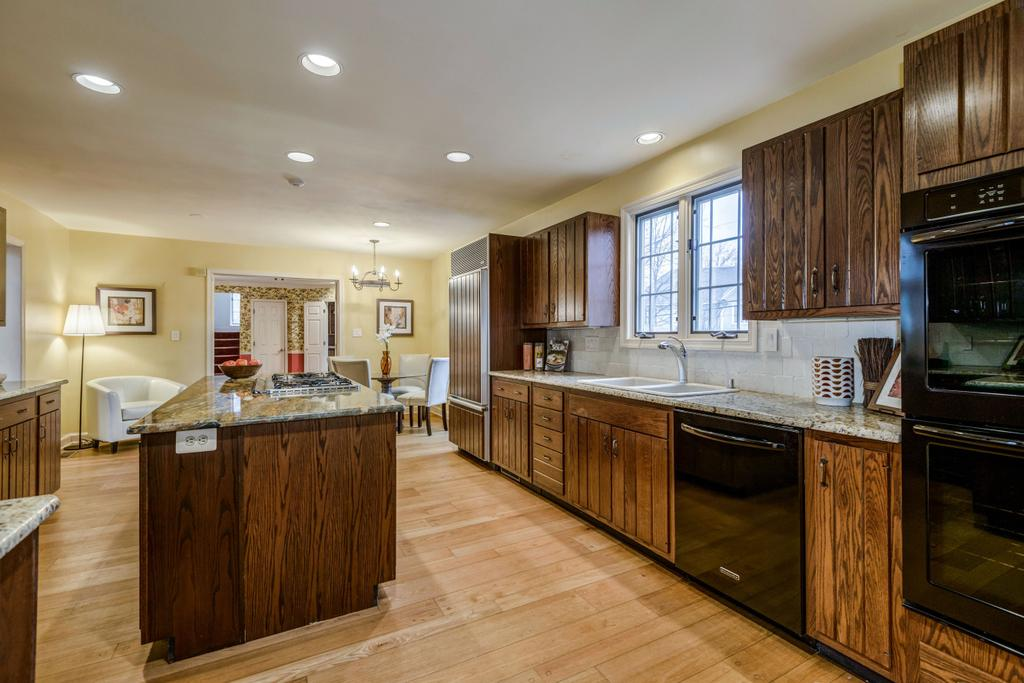 FEATURES 4 bedrooms, 4 full baths, 1 half bath and a spacious floor plan offering hardwood floors, recessed lighting, and large windows Welcoming two-story, light filled entrance leads to the center