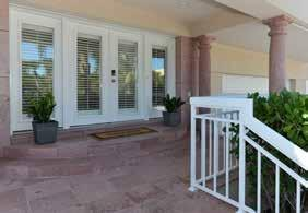 FOYER Size: 14 3 x 11 4 Full-light, double entry doors with side lights and wood Plantation shutters