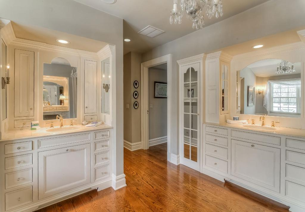 views over property French door to terrace Dressing rooms with multiple walk-in closets with custom built-ins Cedar closet Sound system Master Bath: Luxurious Master Bathroom with double vanities
