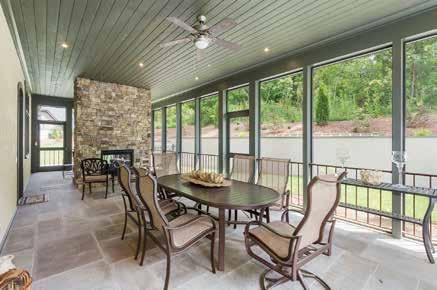 Perfect for entertaining with an amazing stone tiled outdoor screened patio including a double-sided fireplace accessible from multiple rooms in the home Oversized windows for great natural light
