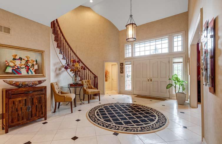 Spectacular all brick 8,062 sq ft 5 bedroom, 5 1/2 bath Colonial on private.81 lushly landscaped property with pool with Aqualink, ideally located on a quiet cul de sac.