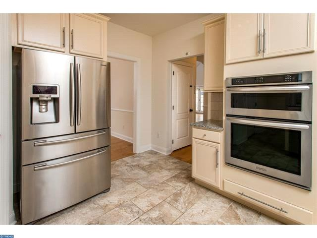 The gourmet kitchen features stainless steel appliances, granite countertops and breakfast nook.