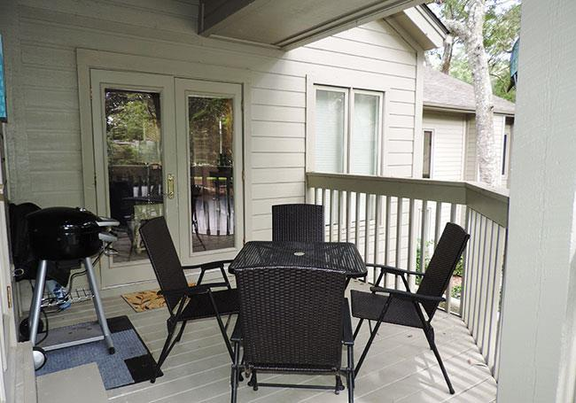 Private covered deck is great for grilling outside, and