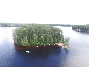 over 20 acres close to several lakes & on snowmobile trail. Det.