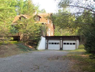ranch located on snowmobile/atv trails with 2 car detached garage, full basement & one acre